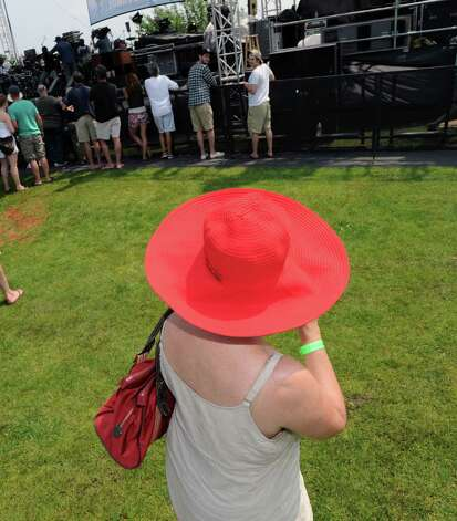 Jeannine Matoff of Greenwich wears a red hat during the Greenwich Town Party at Roger Sherman Baldwin Park, Saturday, May 26, 2012. Photo: Bob Luckey / Greenwich Time