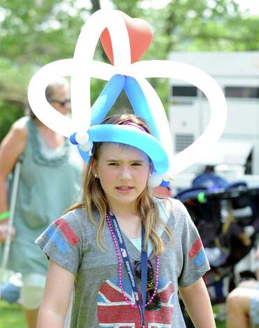 Leah Caputo, 9, of Greenwich, wears a ballon hat during the Greenwich Town Party at Roger Sherman Baldwin Park, Saturday, May 26, 2012. Photo: Bob Luckey / Greenwich Time