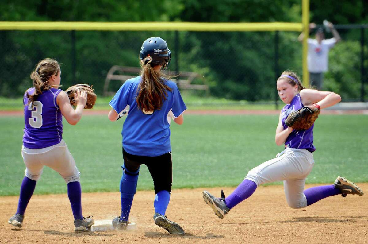 Westhill High School's Morgan Kurtz tries to get Darien High School's Emma Hamilton out at second but the runner was safe during the FCIAC Softball Championship game at Sacred Heart University, Fairfield, CT. Saturday May, 26th, 2012.
