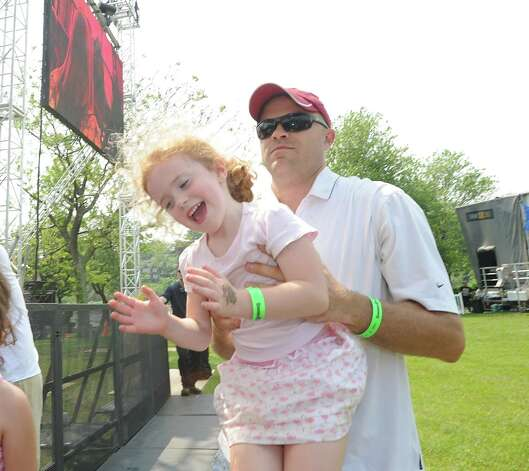 Dave Carrescia of Greenwich and his daughter Taylor, 5, enjoy the Kirk Franklin Band during the Greenwich Town Party at Roger Sherman Baldwin Park, Saturday, May 26, 2012. Photo: Bob Luckey / Greenwich Time