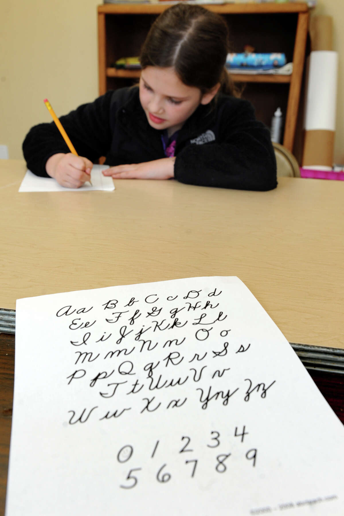Sarah Buttress, 9, practices her cursive in a cursive enrichment class, in Trumbull, Conn. April 11th, 2012.