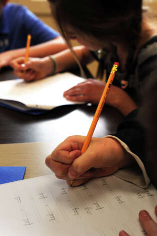 Students practice their cursive in a cursive enrichment class, in Trumbull, Conn. April 11th, 2012. Photo: Ned Gerard / Connecticut Post