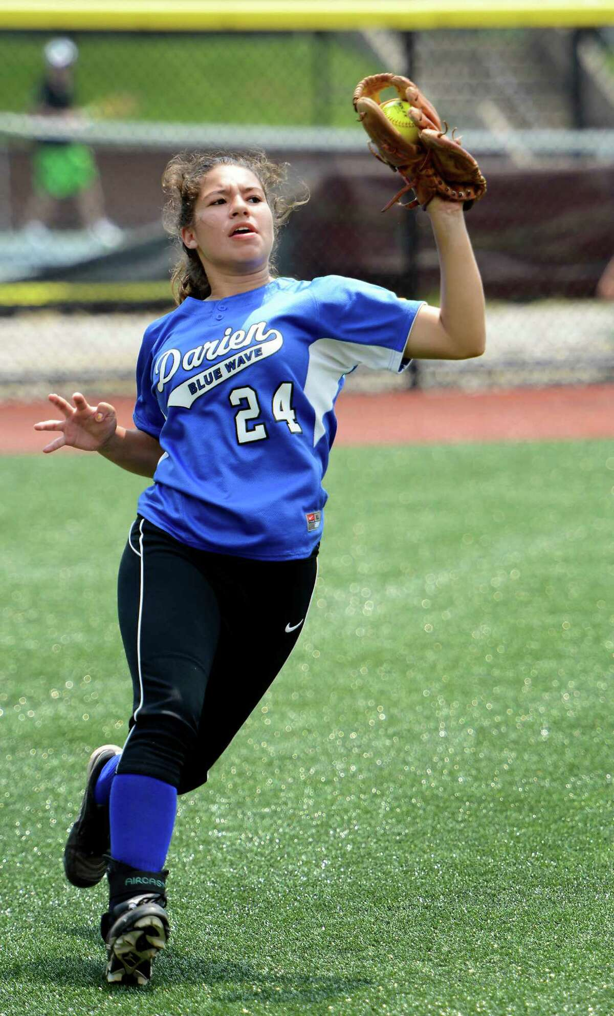 Darien High School left fielder Alexandra Aparicio catches a fly ball in the FCIAC Softball Championship game vs Westhill High School at Sacred Heart University, Fairfield, CT. Saturday May, 26th, 2012.