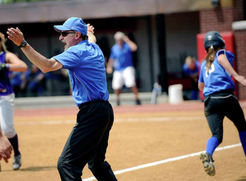 Darien High School coach Nick DeMaio instructs his base runners from third base in the FCIAC Softball Championship game vs Westhill High School at Sacred Heart University, Fairfield, CT. Saturday May, 26th, 2012.