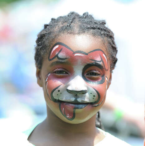 A face-painted Madison Rabb, 8, of Greenwich during the Greenwich Town Party at Roger Sherman Baldwin Park, Saturday, May 26, 2012. Photo: Bob Luckey / Greenwich Time