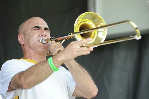 Vinny Nobile performs on the trombone with Roy & The Munsons during the Greenwich Town Party at Roger Sherman Baldwin Park, Saturday, May 26, 2012. Photo: Bob Luckey / Greenwich Time