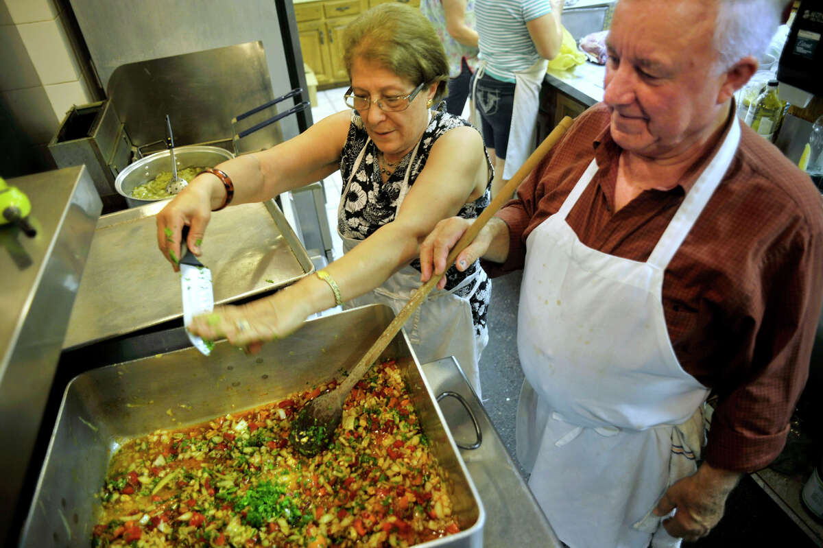 Irene Vendinha and Joe Ferrera prepare a stew for the Santo Cristo Festival at the Immaculate Heart of Mary Parish in Danbury on Saturday, May 26, 2012.
