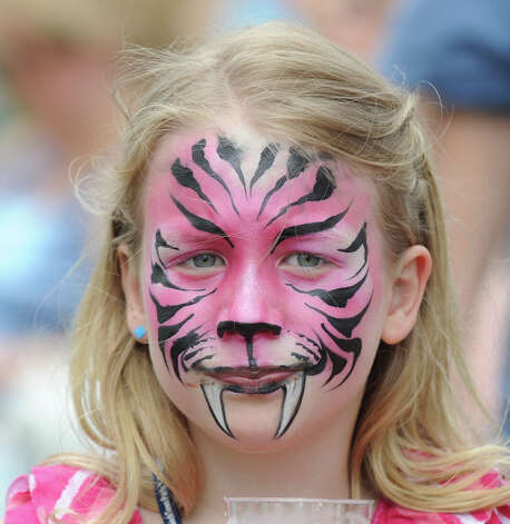 Bennett Barth, 7, of Riverside, displays her painted face during the Greenwich Town Party at Roger Sherman Baldwin Park, Saturday, May 26, 2012. Photo: Bob Luckey / Greenwich Time