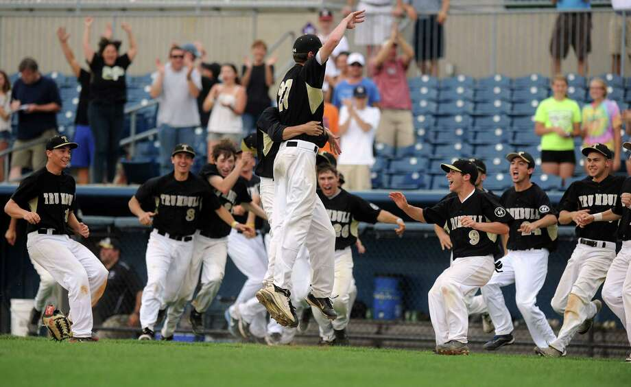 Trumbull players celebrate winning Saturday's FCIAC baseball championship game against Greenwich at the Ballpark at Harbor Yard in Bridgeport on May 26, 2012. Photo: Lindsay Niegelberg / Stamford Advocate