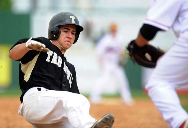 Trumbull's Ryan Fritz slides safely into third base during Saturday's FCIAC baseball championship game at the Ballpark at Harbor Yard in Bridgeport on May 26, 2012. Photo: Lindsay Niegelberg / Stamford Advocate