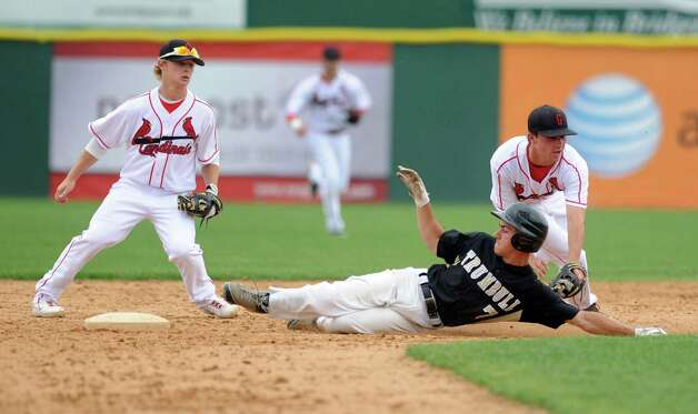 Greenwich's Dylan Callahan reaches to tag Trumbull's Ryan Fritz at second base during Saturday's FCIAC baseball championship game at the Ballpark at Harbor Yard in Bridgeport on May 26, 2012. Photo: Lindsay Niegelberg / Stamford Advocate
