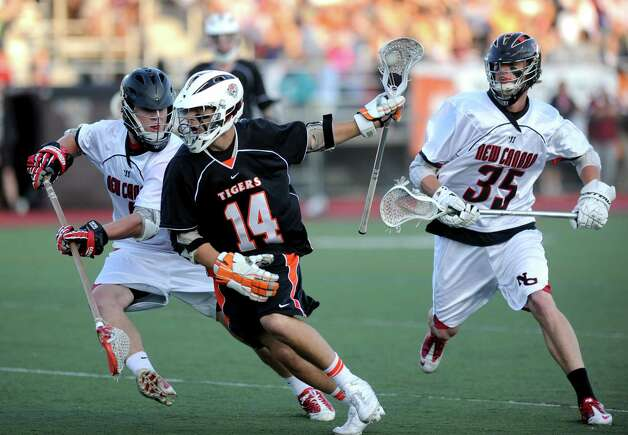Ridgefield's Eric Scala controls the ball during Friday's FCIAC boys lacrosse championship game at Brien McMahon High School in Norwalk on May 25, 2012. Photo: Lindsay Niegelberg / Stamford Advocate