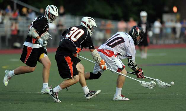 New Canaan's Peter Kraus controls the ball during Friday's FCIAC boys lacrosse championship game at Brien McMahon High School in Norwalk on May 25, 2012. Photo: Lindsay Niegelberg / Stamford Advocate