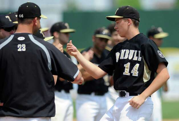 Trumbull's Carl Johnson gets a fist bump as his team is introduced during Saturday's FCIAC baseball championship game against Greenwich at the Ballpark at Harbor Yard in Bridgeport on May 26, 2012. Photo: Lindsay Niegelberg / Stamford Advocate