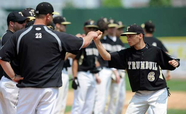Trumbull's Brandon Liscinsky gets a fist bump as his team is introduced during Saturday's FCIAC baseball championship game against Greenwich at the Ballpark at Harbor Yard in Bridgeport on May 26, 2012. Photo: Lindsay Niegelberg / Stamford Advocate