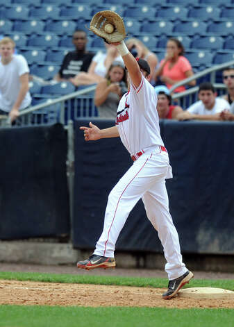 Greenwich's Kyle Ballone makes a catch at first base during Saturday's FCIAC baseball championship game at the Ballpark at Harbor Yard in Bridgeport on May 26, 2012. Photo: Lindsay Niegelberg / Stamford Advocate