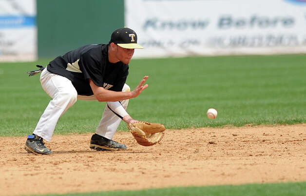 Trumbull's Brandon Liscinsky fields a ball during Saturday's FCIAC baseball championship game at the Ballpark at Harbor Yard in Bridgeport on May 26, 2012. Photo: Lindsay Niegelberg / Stamford Advocate