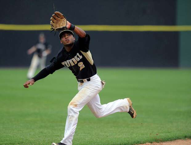 Trumbull's Marcus Jenkins makes a catch in the infield during Saturday's FCIAC baseball championship game at the Ballpark at Harbor Yard in Bridgeport on May 26, 2012. Photo: Lindsay Niegelberg / Stamford Advocate