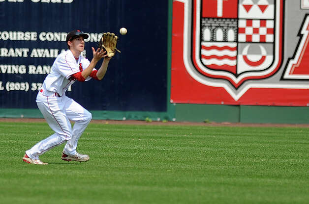 Greenwich's David Berdoff makes a catch in the outfield during Saturday's FCIAC baseball championship game at the Ballpark at Harbor Yard in Bridgeport on May 26, 2012. Photo: Lindsay Niegelberg / Stamford Advocate