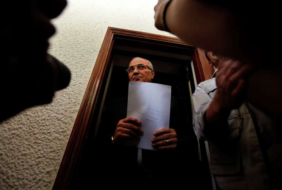 "Egyptian presidential candidate Ahmed Shafiq, seen Saturday before a news conference at his office in Cairo, paid tribute to the ""glorious revolution"" that toppled Hosni Mubarak, a dramatic turn-around for the former regime official. Photo: Khalil Hamra / AP"