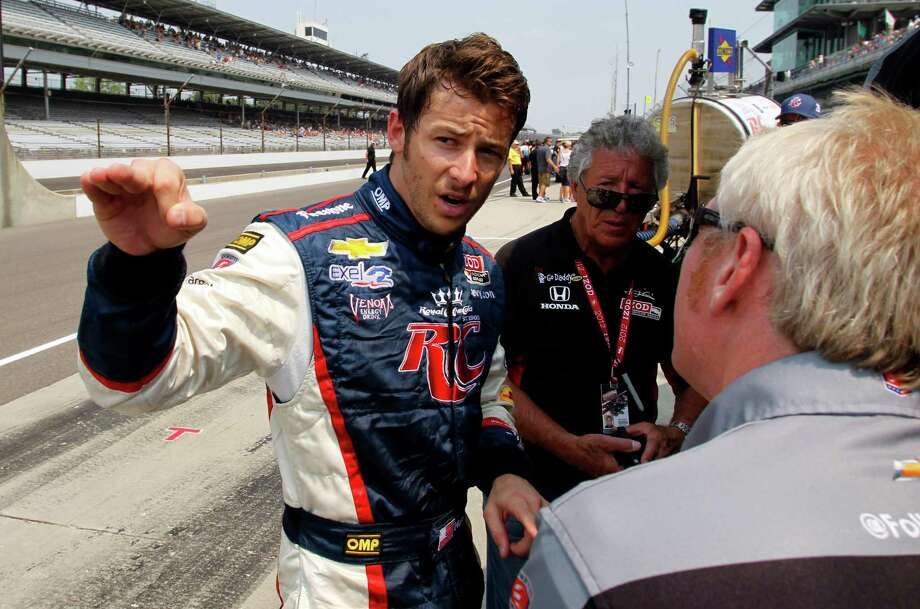 Marco Andretti (left) chats with a crew member and his grandfather, 1969 Indy 500 champion Mario Andretti. Photo: AP