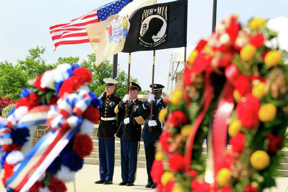 An honor guard stands near wreaths honoring the fallen during Memorial Day ceremonies at Brig. General William C. Doyle Veterans Memorial Cemetery in Wrightstown N.J., Saturday, May 26, 2012. Photo: Mel Evans, Associated Press / AP
