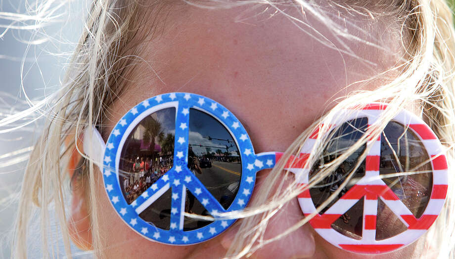 Carlie Eudy of the  Myrtle Beach Speedway wears patriotic sunglasses during the annual Memorial Day Parade on Ocean Boulevard in Myrtle Beach, S.C.  on Saturday, May 26, 2012. Photo: Janet Blackmon Morgan, Associated Press / ©The Sun News 2011
