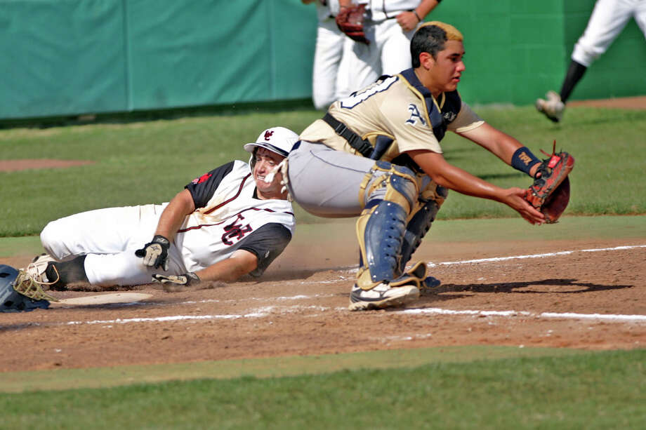 Churchill's  Justin Kelly slides into home to score the first run for the Charger in the 4th inning as Laredo Alexander catcher Danny Benavides awaits for the throw. Photo: Clara Sandoval, Laredo Morning Times