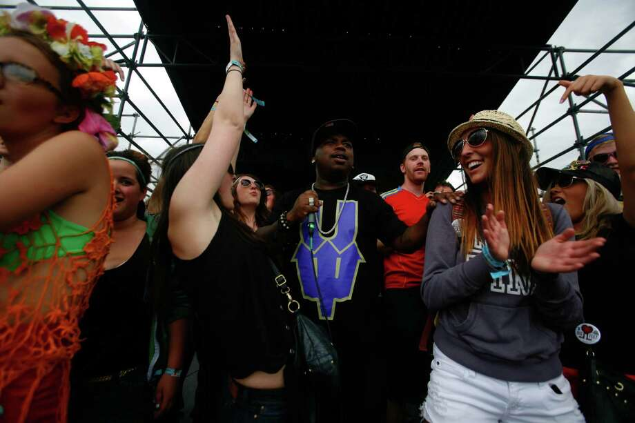Concert attendees dance with Fatal Lucciauno, a rapper. Photo: SOFIA JARAMILLO / SEATTLEPI.COM