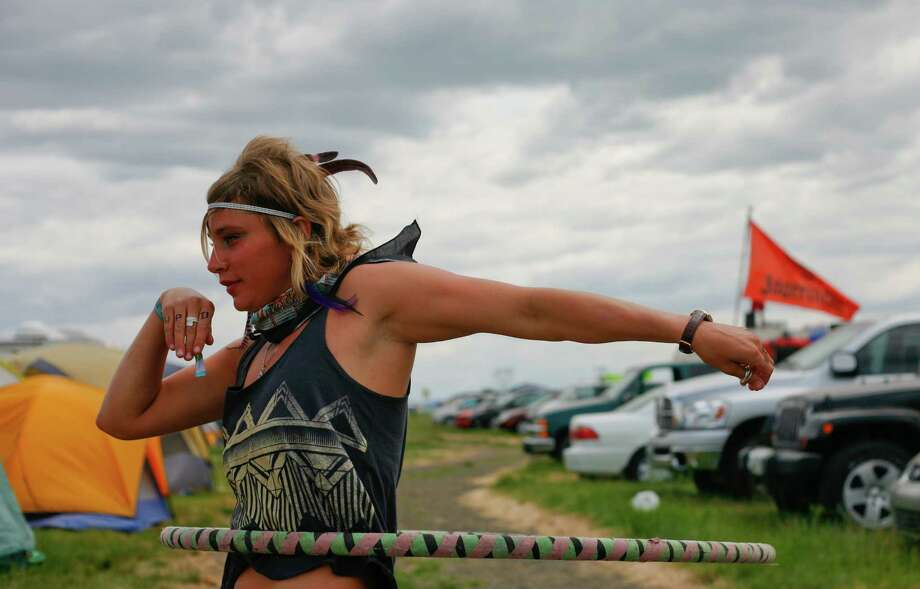 Amelia Vos dances with her hula hoop at the campground. Photo: SOFIA JARAMILLO / SEATTLEPI.COM