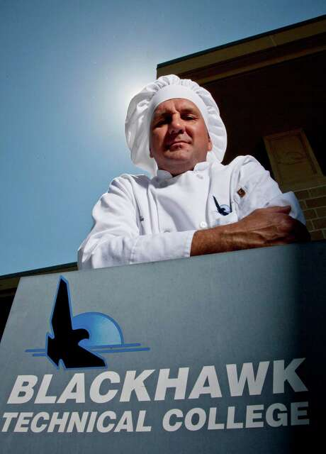 Mike Szlamczynski shifted career gears, leaving his job as an auto worker at 41 to enroll at the Blackhawk Tech College to learn how to become a chef. Photo: Morry Gash / AP