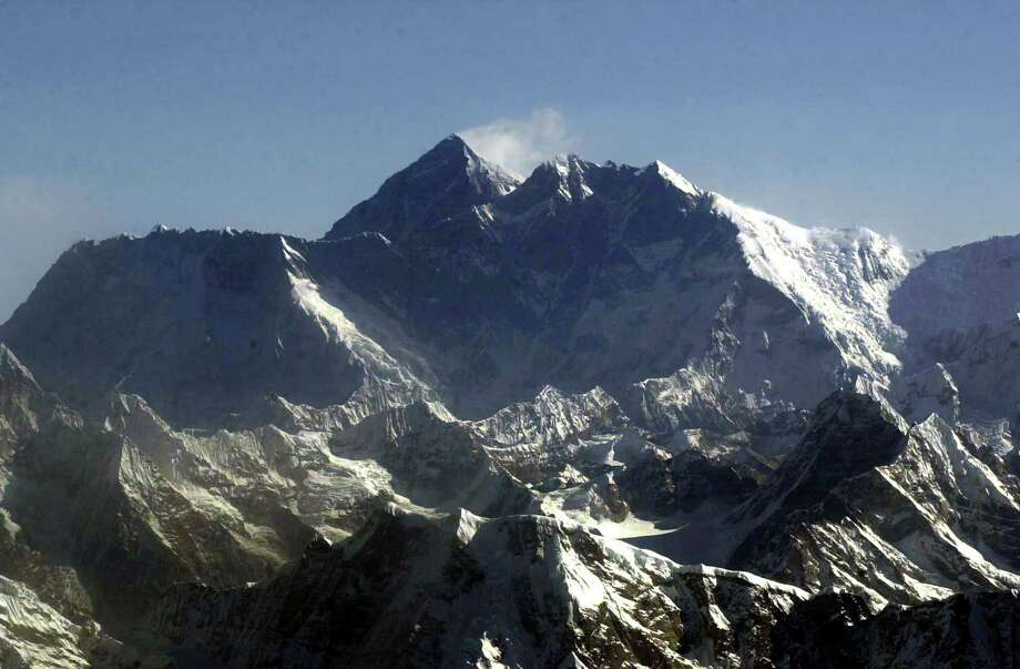 "FILE - In this Tuesday, May 6, 2003 file photo, Mount Everest, at 8,850-meter (29,035-foot), the world's tallest mountain situated in the Nepal-Tibet border as seen from an airplane. Days after four people died amid a ""traffic jam"" of climbers scrambling to conquer Mount Everest, Nepal officials said a similar rush up the world's tallest peak will begin soon, and there's little they can do to control it. (AP Photo/Binod Joshi, File) Photo: Binod Joshi / AP"