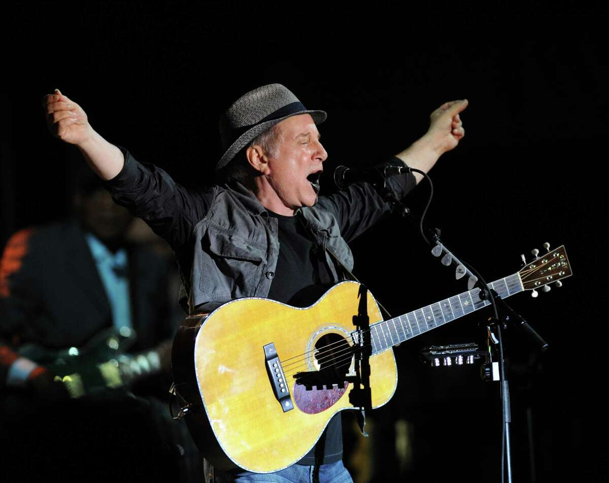 Paul Simon performs during the Greenwich Town Party at Roger Sherman Baldwin Park, Saturday, May 26, 2012.