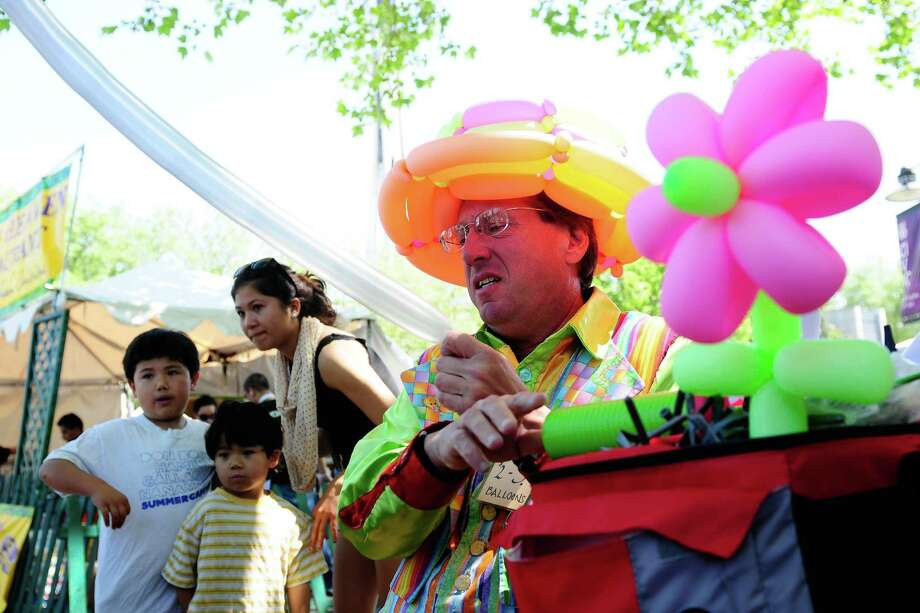 Chris, no last name given, prepares a balloon animal at his booth during the 2012 Northwest Folklife Festival at Seattle Center on Saturday, May 26, 2012. The free festival, now in its 41st year, continues through Memorial Day and features music, dance and food from many different traditions. Photo: LINDSEY WASSON / SEATTLEPI.COM