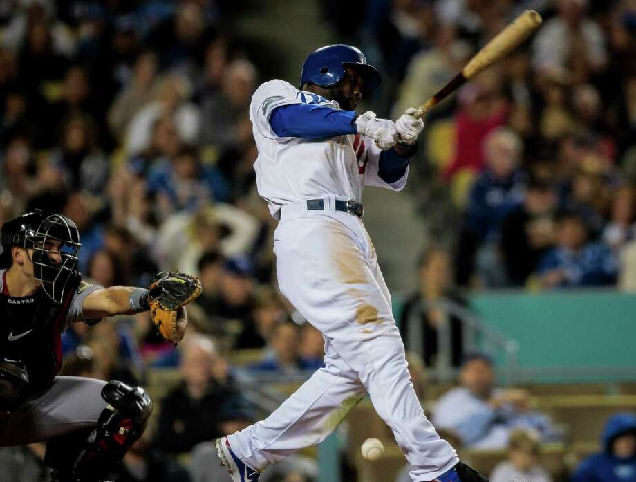 Los Angeles Dodgers left fielder Tony Gwynn fouls the ball off during the fourth inning of a baseball game against the Houston Astros, Saturday, May 26, 2012, in Los Angeles. Gwynn hit a 2 RBI double during this at bat. (AP Photo/Bret Hartman) Photo: Bret Hartman / FR139655 AP