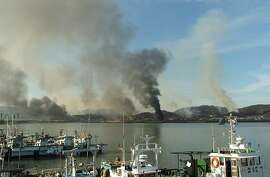 YEONPYEONG ISLAND, SOUTH KOREA - NOVEMBER 23:  In this image provided by a local resident, Smoke rises from South Korea's Yeonpyeong island near the border against North Korea on November 23, 2010 in Seoul, South Korea. Dozens of artillery shells fired byNorth Korea hit the South Korean Island of Yeonpyeong reportedly causing injuries and prompting return fire from South Korean forces. The incident comes amid tensions over North Korea's nuclear program and the announcement of North Korean leader Kim JongIl's youngest son as his successor.