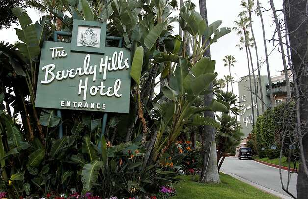 In this April 25, 2012 photo, the entrance to the Beverly Hills Hotel is seen in Beverly Hills, Calif.  The Beverly Hills Hotel is celebrating its 100th anniversary this year. (AP Photo/Matt Sayles) Photo: Matt Sayles, Associated Press