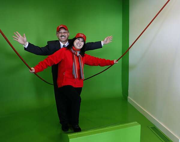 Mayor Ed Lee poses for a photo with his wife Anita in front of a green screen in the renovated Roundhouse building during a dedication ceremony at the Golden Gate Bridge in San Francisco, Calif. on Friday, May 25, 2012. The event kicked off a weekend of events to celebrate the iconic bridge's 75th anniversary. Photo: Paul Chinn, The Chronicle