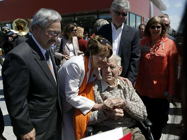 Rep. Nancy Pelosi hugs Gus Villalta, an ironworker who helped build the Golden Gate Bridge 75-years ago, as Mayor Ed Lee looks on during a dedication ceremony for the new Bridge Pavilion in San Francisco, Calif. on Friday, May 25, 2012. The event kicked off a weekend of events to celebrate the iconic bridge's 75th anniversary. Photo: Paul Chinn, The Chronicle