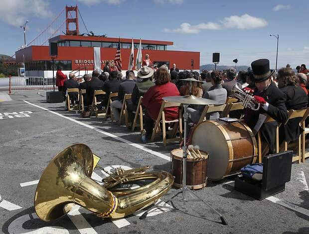 Franklin Davis (right) organizes musical instruments during a dedication ceremony for the new Golden Gate Bridge Pavilion in San Francisco, Calif. on Friday, May 25, 2012. His band, Brassworks, performed during the event, which kicked off a weekend of events to celebrate the iconic bridge's 75th anniversary. Photo: Paul Chinn, The Chronicle
