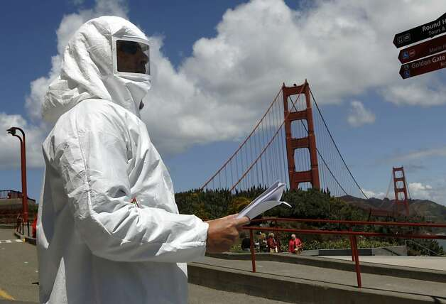 A protester distributes information warning of lead contamination from the Golden Gate Bridge repainting project during a dedication ceremony for the new Bridge Pavilion in San Francisco, Calif. on Friday, May 25, 2012. The event kicked off a weekend of events to celebrate the iconic bridge's 75th anniversary. Photo: Paul Chinn, The Chronicle