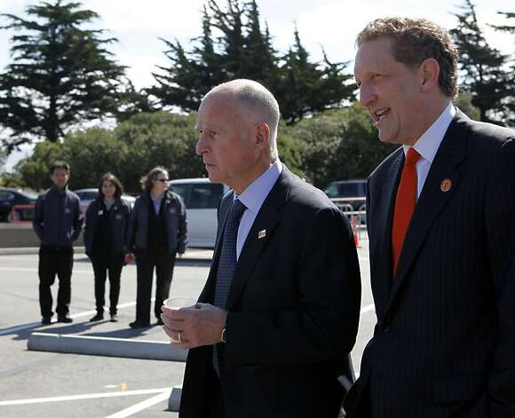 Gov. Jerry Brown and event co-chair Larry Baerarrive for the dedication ceremony for the new Golden Gate Bridge Pavilion in San Francisco, Calif. on Friday, May 25, 2012. The event kicked off a weekend of events to celebrate the iconic bridge's 75th anniversary. Photo: Paul Chinn, The Chronicle