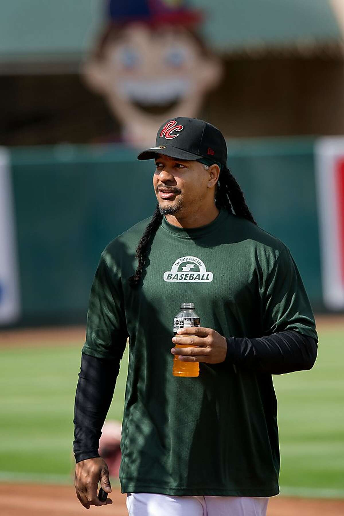 The River Cats' left fielder Manny Ramirez (11) speaks to reporters prior to the game between the Sacramento River Cats and the Reno Aces at Raley Field in West Sacramento on Friday, May 25, 2012.