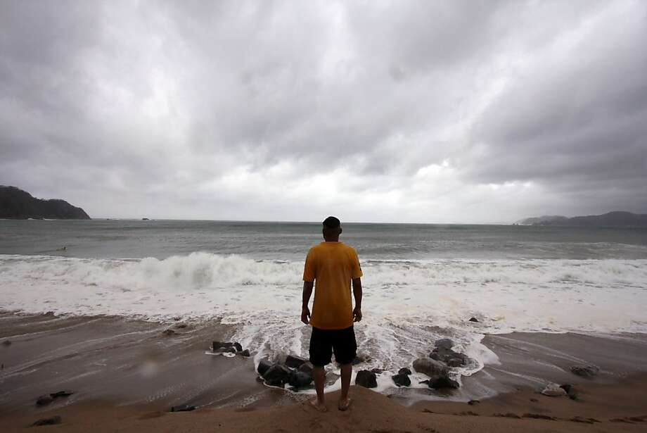A man stares at the sea on the beach in Barra de Navidad, Jalisco State, Mexico, on May 25, 2012 as Hurricane Bud, which was downgraded to a category one storm, is set to make landfall later in the day. Hurricane Bud was weakened to a Category one storm early Friday but was still on track to make landfall on the southwestern coast of Mexico as the first eastern Pacific hurricane of the 2012 season.  AFP PHOTO/Hector GUERREROHECTOR GUERRERO/AFP/GettyImages Photo: Hector Guerrero, AFP/Getty Images