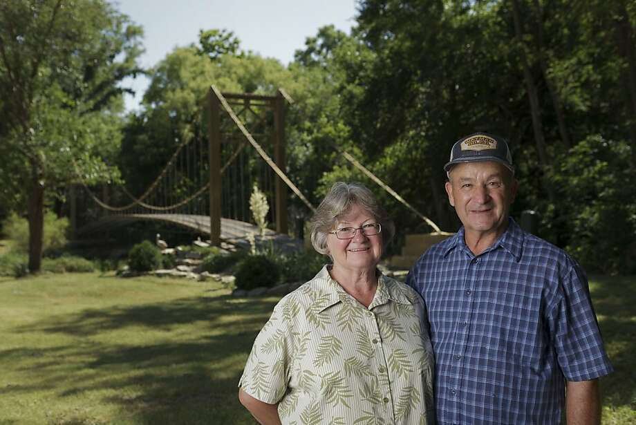 MULVANE, KS  -  MAY 21, 2012  Larry and Barbara Richardson have a replica Golden Gate Bridge on their property in Mulvane, KS.  The suspension bridge was built by Larry, his brother and his father over a 7-8 year time span.  The group started the project in 1994 and finished it up in August 2001.  They poured all the concrete they needed by themselves with bags of concrete.  Larry said he got the timbers for the bridge for free and the cables too.   Larry bought a postcard of the Golden Gate Bridge while in California briefly while shipping out to Vietnam in 1968 while in the Army.  That postcard he kept all those years and used it as the guide for how he would build his replica bridge.  He did no engineering for the project he just looked at the picture and figured out how to make it work.  His bridge crosses the small Cowskin Creek and he can now access a small section of his land that he wasn't able to before.  Larry painted his bridge a gold color, unlike the original Golden Gate Bridge.  He says he has to buy the paint from a local hardware store and they only sell it in pint containers.  He has painted the bridge twice, every time with a 1 inch trim brush. Photo: Steve Hebert