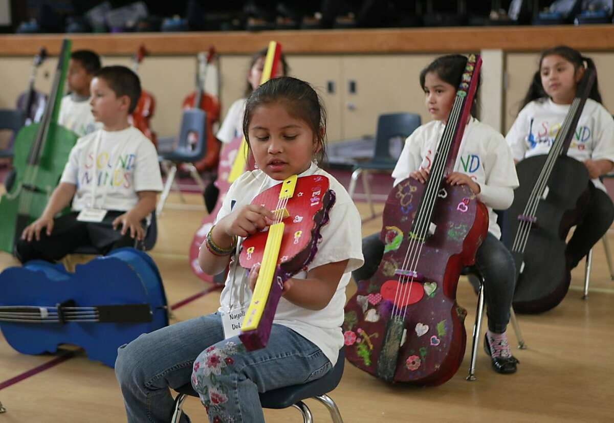 The students of Downer Elementary school have traded in their cardboard instruments for their brand new violins and cellos donated by the California Symphony on Friday, May 25th, 2012 in San Pablo, Calif.