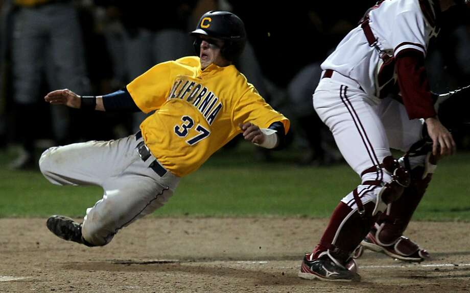 University of California Mike Reuvekamp scores the go ahead run in the top of the 18th inning to go ahead of the Stanford Cardinal 5-4 at StanfordÕs Sunken Diamond Friday, May 25, 2012 in Stanford Calif. Photo: Lance Iversen, The Chronicle