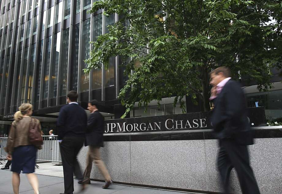 Pedestrians walk past JPMorgan Chase headquarters in New York, Wednesday, May 16, 2012.  Rep. Shelly Moore Capito, chairman of the House Financial Services subcommittee, on Wednesday said that the $2 billion trading loss at JPMorgan Chase raises critical questions about how banks control their risks. But Republican lawmakers rejected calls from Democrats for stricter oversight of Wall Street.  (AP Photo/Seth Wenig) Photo: Seth Wenig, Associated Press