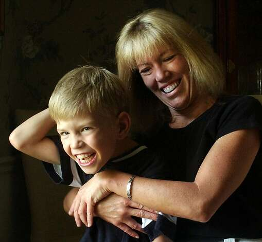 Susan Sheridan and her 8-year-old son, Cal, who suffered from severe jaundice as a newborn and now sufferes from a a severe type of cerebral palsy, are shown Friday, Aug. 14, 2003, in Quincy, Ill. Jaundice is common in newborns, but many parents don't realize that severe jaundice can drastically damage their infants' brains unless it's promptly treated, a preventable cause of disability that some experts fear may be on the rise.  (AP Photo/Phillip Carlson) Photo: Phillip Carlson, ASSOCIATED PRESS