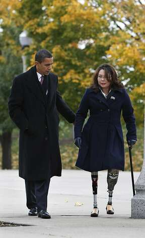 President-elect Obama and Iraq war veteran Tammy Duckworth, director, Illinois Department of veterans Affairs, arrive for a wreath laying ceremony at the Bronze Soldiers Memorial in honor of Veteran's Day, Tuesday, Nov. 11, 2008, in Chicago. (AP Photo/Pablo Martinez Monsivais) Photo: Pablo Martinez Monsivais, AP